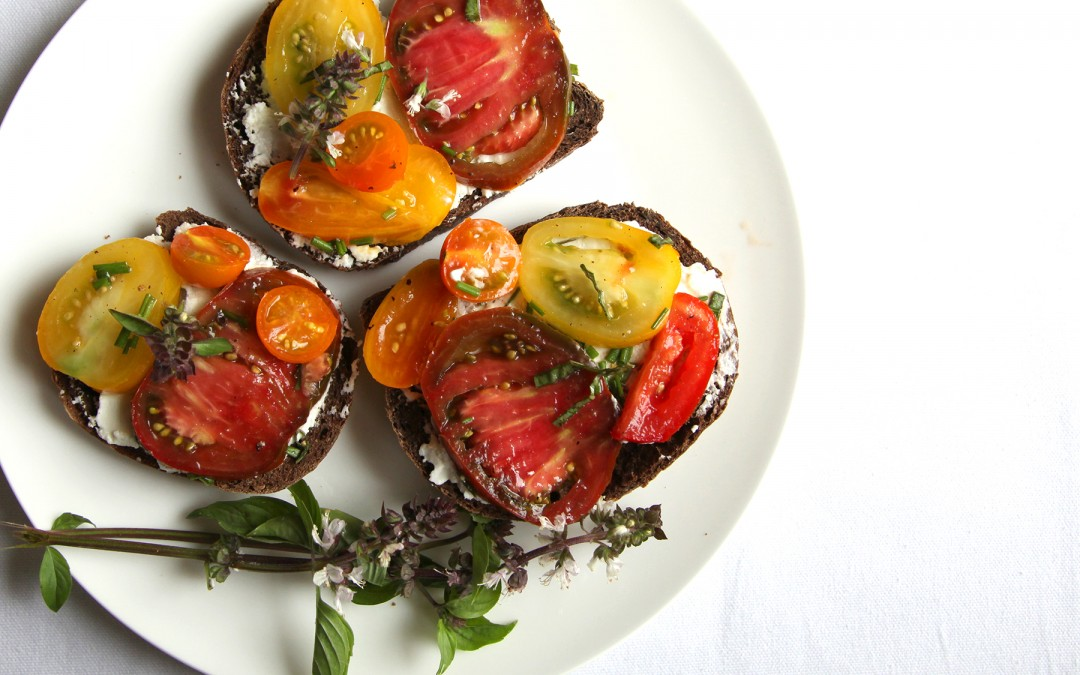 Pumbernickle Toast with Heirloom Tomatoes and Chèvre